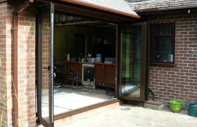 Aluminium bi-fold doors, (open).