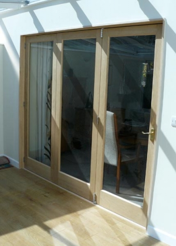 Timber folding doors.