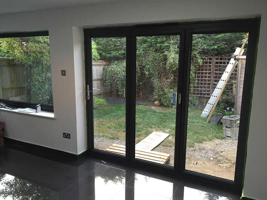 Anthracite grey aluminium bi-folding doors, 3 section.