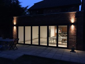 Anthracite grey aluminium bi-folding doors, 6 sections, (closed).