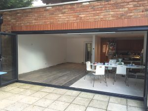 Anthracite grey aluminium bi-folding doors, 6 sections, (open).