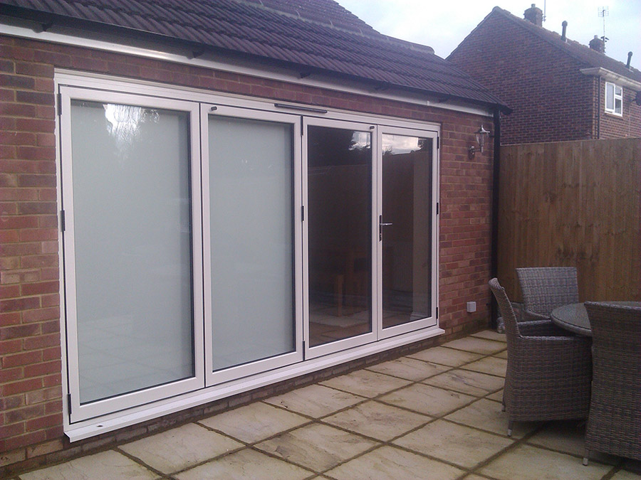 White aluminium bi-folding doors, 4 sections.