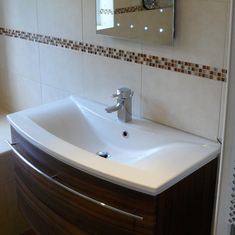 Curved sink and tiling.